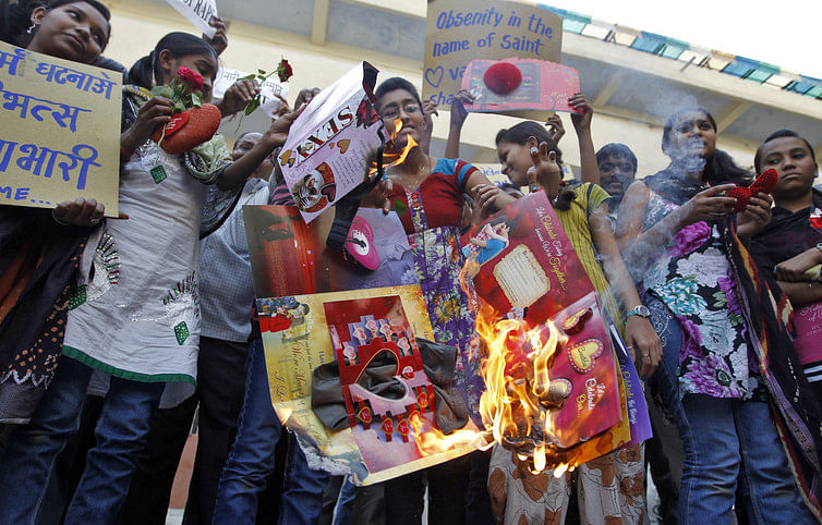 Students burn Valentine Day's greetings card, claiming they are contrary to Indian values. (Photo: Reuters)
