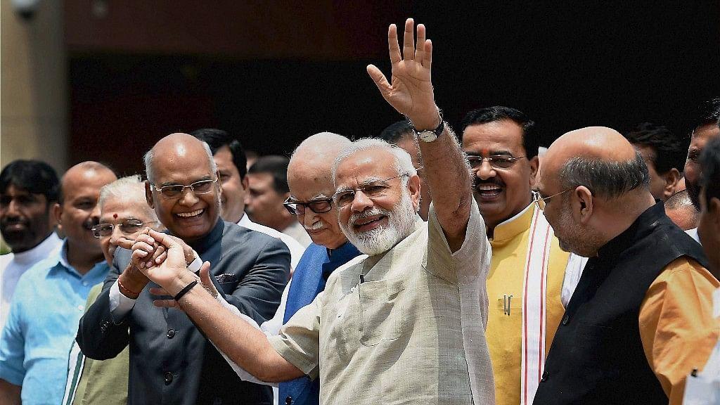 NDA's Presidential Nominee Ram Nath Kovind before filing his nomination with PM Modi (Photo: PTI)