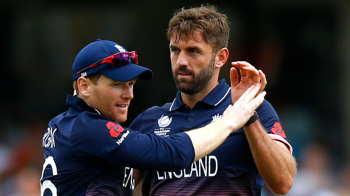 England's Eoin Morgan (L) and Liam Plunkett (R) celebrate a wicket during a match in the Champions Trophy. (Photo: Reuters)