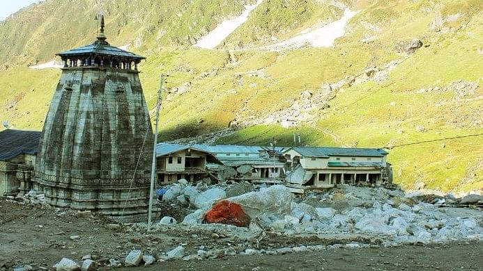 Kedarnath temple with destroyed houses following the 2013 flood disaster.