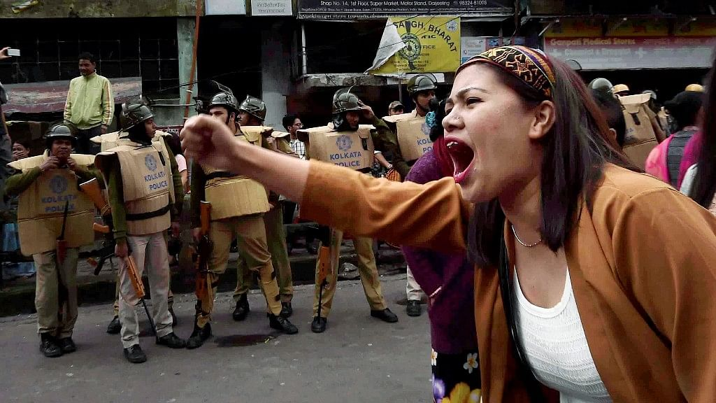 A GJM supporter shouts slogans at a protest rally during the first few days of the Gorkhaland agitation in Darjeeling.