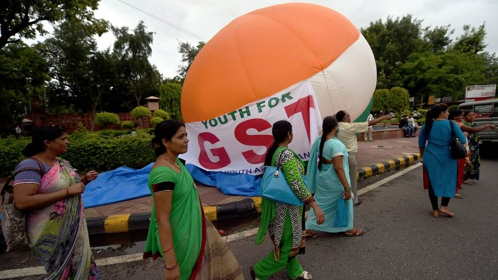 A hot air balloon with a message in support of GST is readied, ahead of the launch event at midnight in New Delhi.
