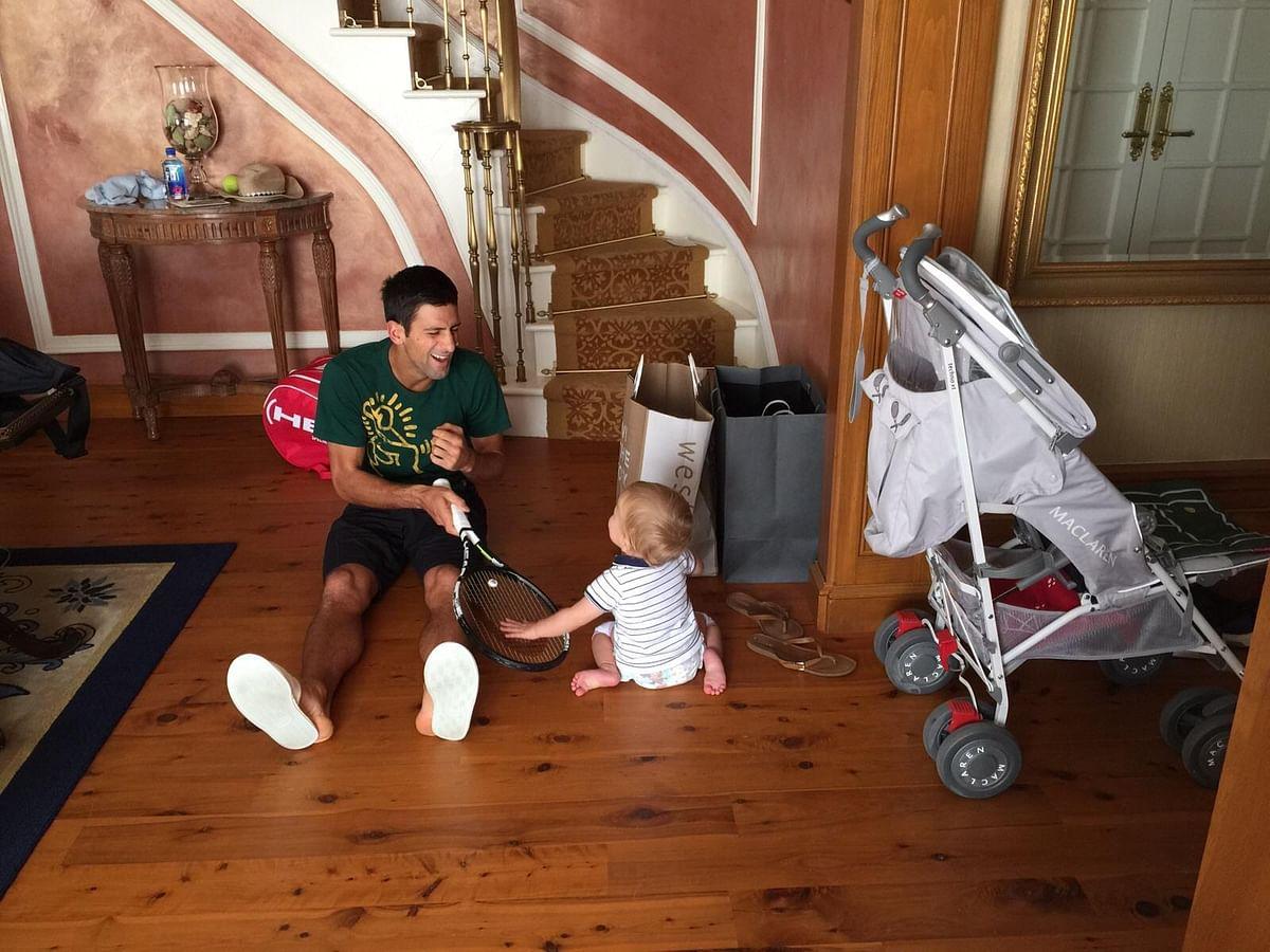 "Novak Djokovic shares a laugh with his son. (Photo Courtesy: <a href=""https://www.facebook.com/pg/djokovic.official/photos/?ref=page_internal"">Facebook/Novak Djokovic</a>)"