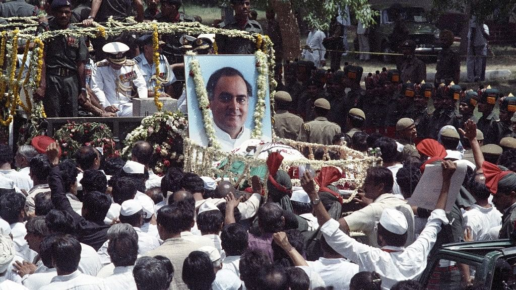 Supporters of former Indian PM Rajiv Gandhi follow his coffin during the funeral procession in New Delhi on 24 May 24 1991.