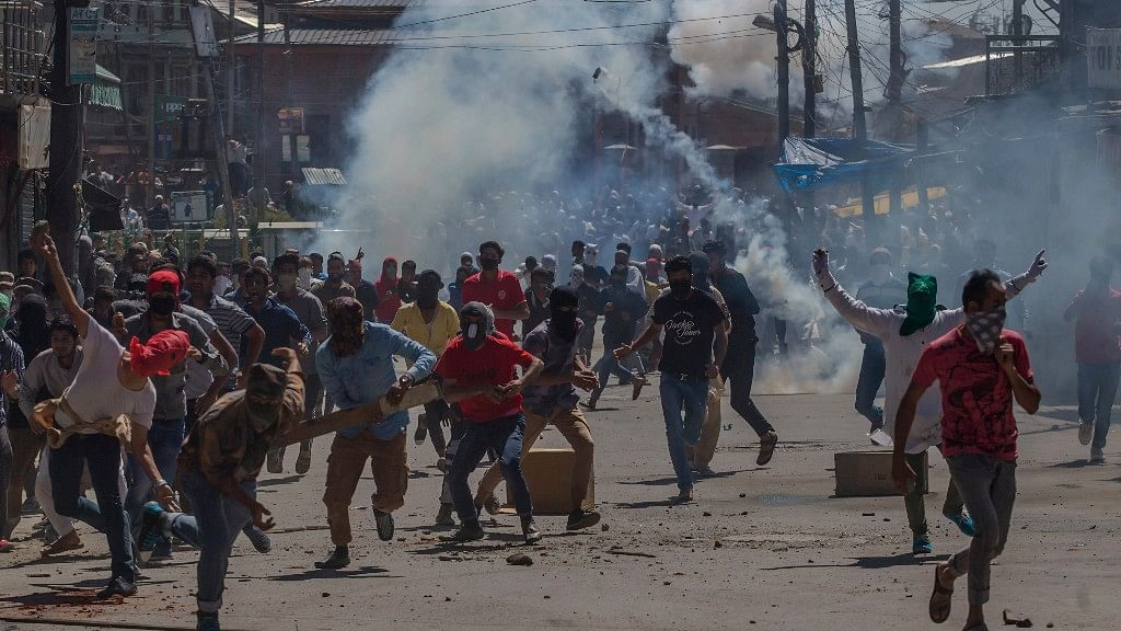Kashmiri protesters clash with security forces during a protest in Srinagar. Image used for representational purpose. (Photo: AP)