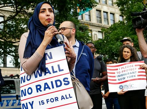 Yemeni American Wadid Hassan speaks to supporters who gathered to protest a travel ban in Union Square, in New York on 29 June 2017.