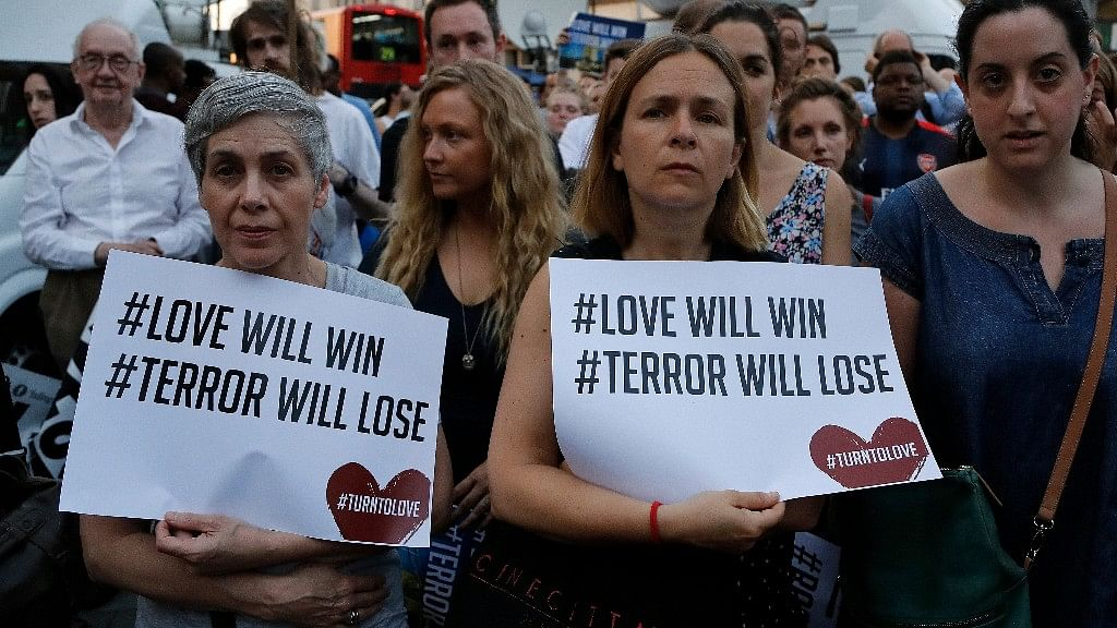 People take part in a vigil at Finsbury Park in north London, where a vehicle struck pedestrians in north London Monday. (Photo: AP)