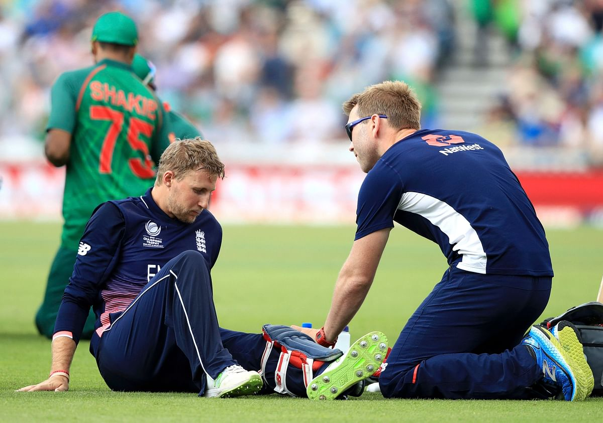 Joe Root receives treatment during the ICC Champions Trophy. (Photo: AP)