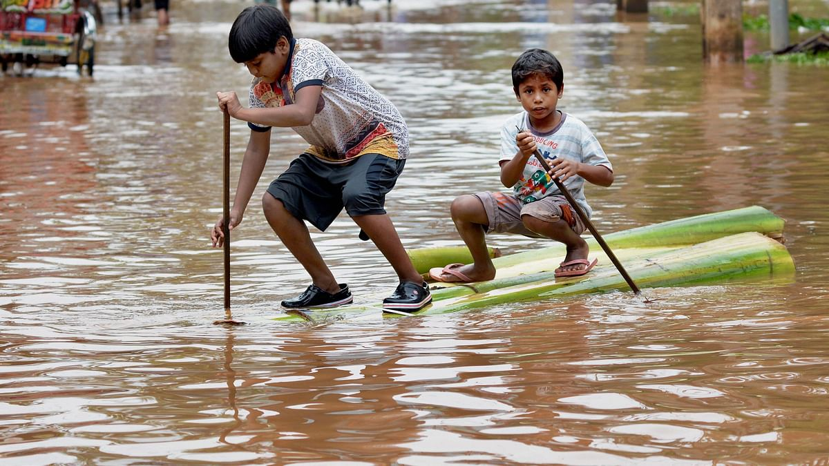 Image of two boys wading a flood street in Guwahati used for representation purpose.