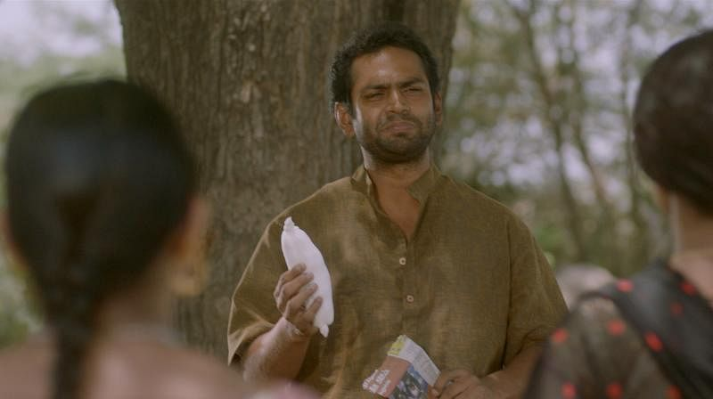 Sharib Ali Hashmi introduces the handmade pad to the women of his village, in a scene from <i>Phullu. </i>