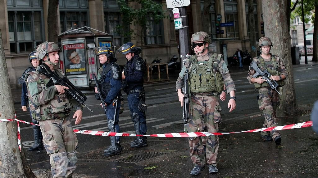 Security personnel at the scene of the attack. (Photo: AP/Christophe Ena)