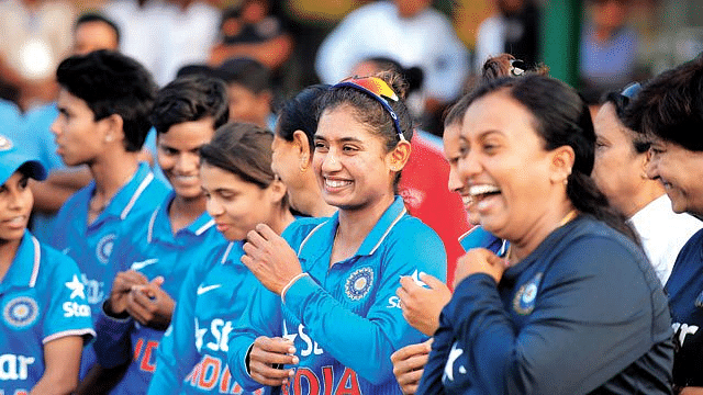 Mithali Raj sharing a light moment with her teammates.
