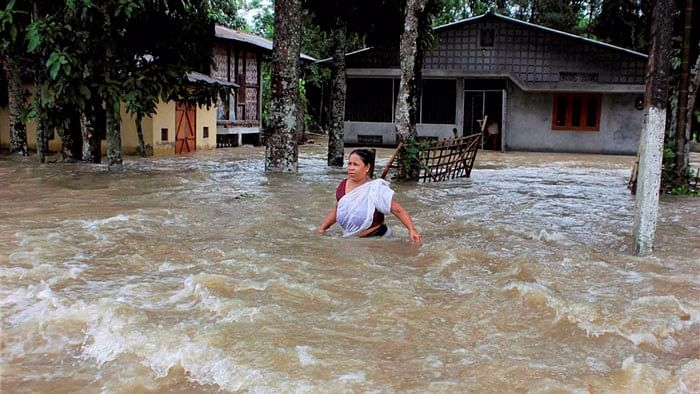 A woman walks through flood water at a village in Sonitpur district of Assam in July 2015.