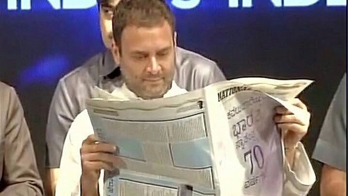 Relax! Rahul Gandhi Was Reading An English Paper – With Kannada Ad