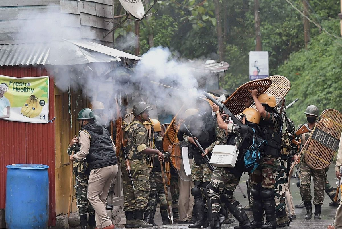 Security personnel shoot tear gas on the protesters. (Photo: PTI)