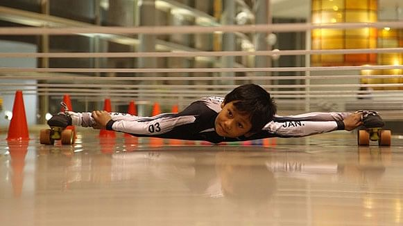 "Limbo skating prodigy Tiluck Keisam broke his own world record in May. (Photo Courtesy: <a href=""http://www.guinnessworldrecords.com/news/2017/5/indias-eight-year-old-limbo-skating-sensation-glides-into-the-record-books-470089"">Guinness World Records</a>)"