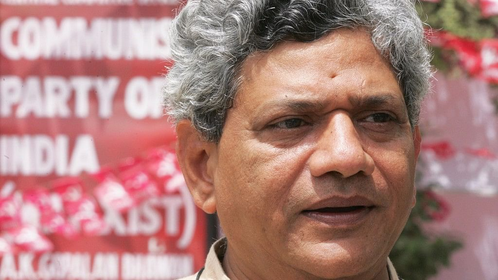 Two youths belonging to a pro-Hindutva outfit manhandled CPI-M General Secretary Sitaram Yechury at a press conference in New Delhi on Wednesday. (Photo: Reuters)