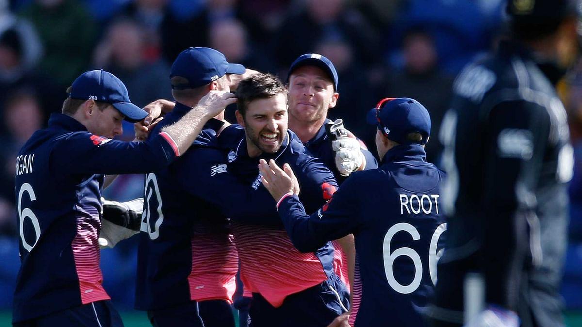 England's Mark Wood celebrates the wicket of New Zealand's Kane Williamson with teammates. (Photo: Reuters)