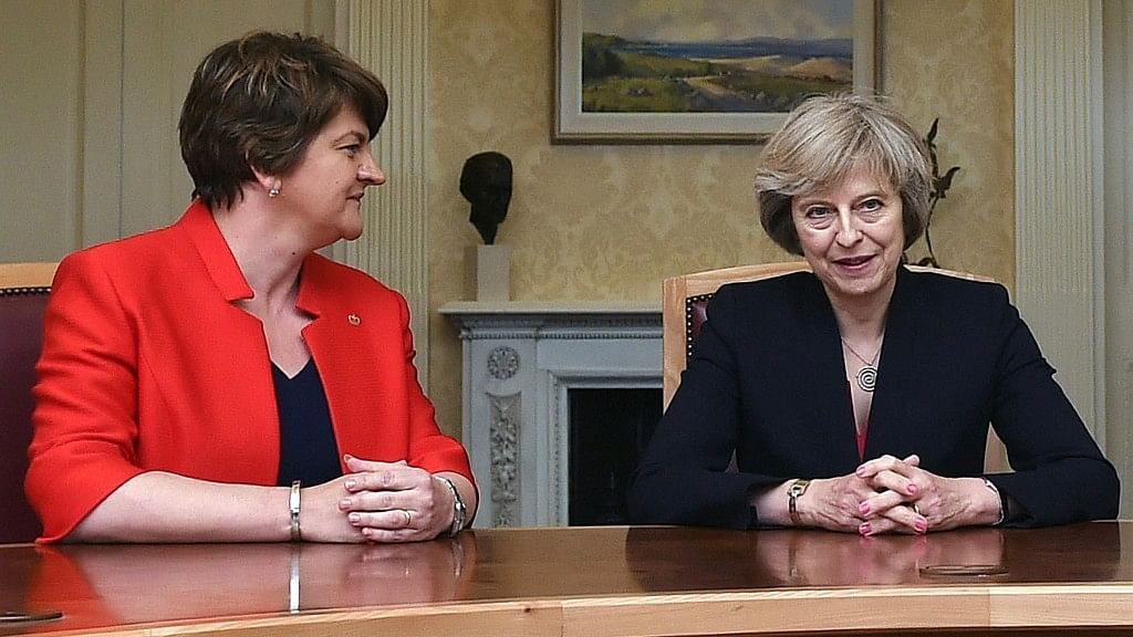 File photo of  Arlene Foster, left, leader of the Democratic Unionist Party, with Britain's Prime Minister Theresa May. (Photo: AP)