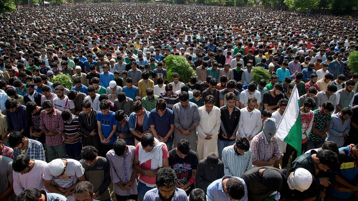 Villagers pray during the funeral of Burhan Wani, in Tral, some 38 kilometers south of Srinagar, Kashmir. Image used for representation. (Photo: AP)