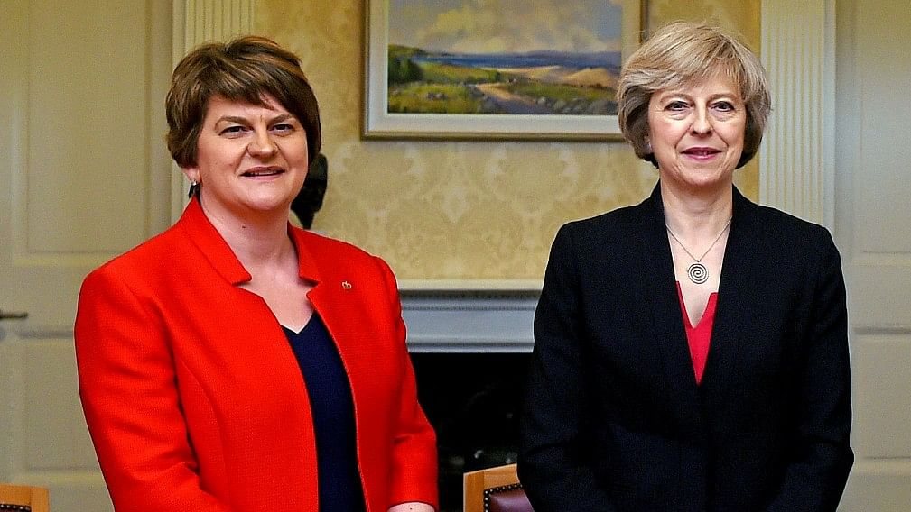 North Ireland's Democratic Unionist Party leader Arlene Foster (left) with Theresa May. (Photo: AP File Photo/Charles McQuillan)
