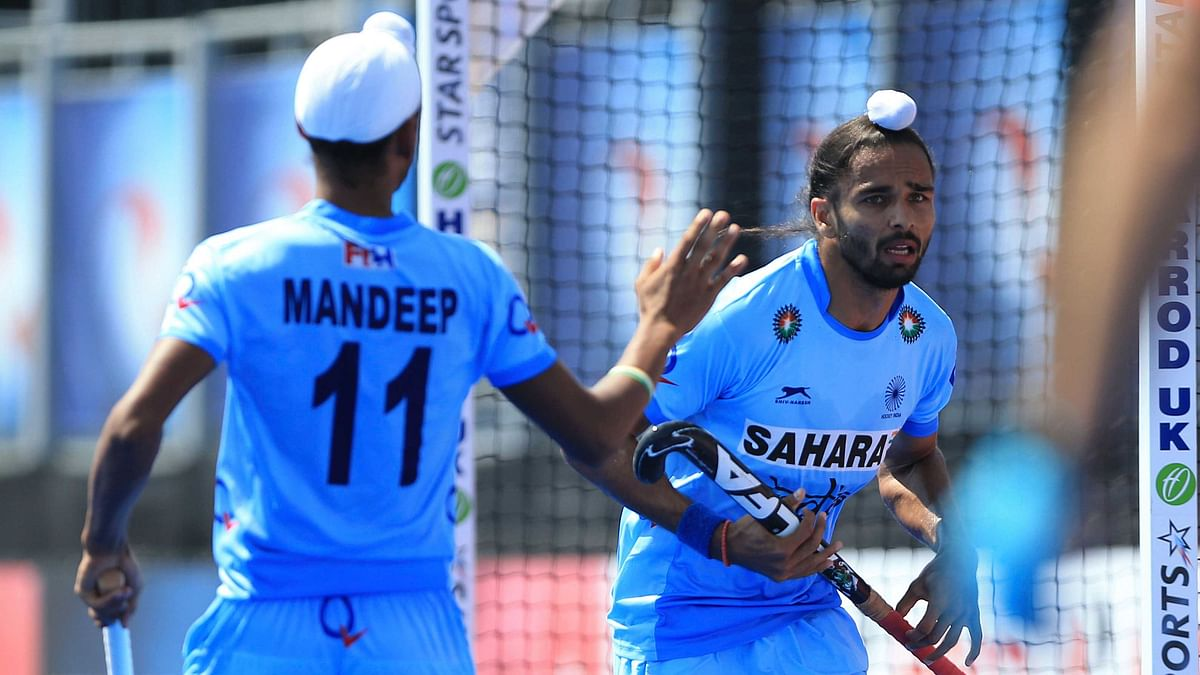 India's Akashdeep Singh (right) celebrates scoring his side's first goal of the game against Netherlands during the Men's World Hockey League match. (Photo: AP)