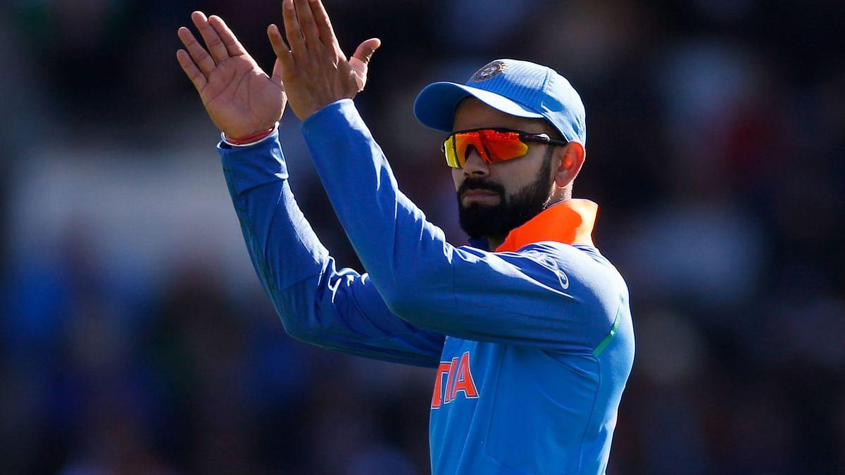 Virat Kohli gestures during the match between India and Pakistan on Sunday. (Photo: Reuters)
