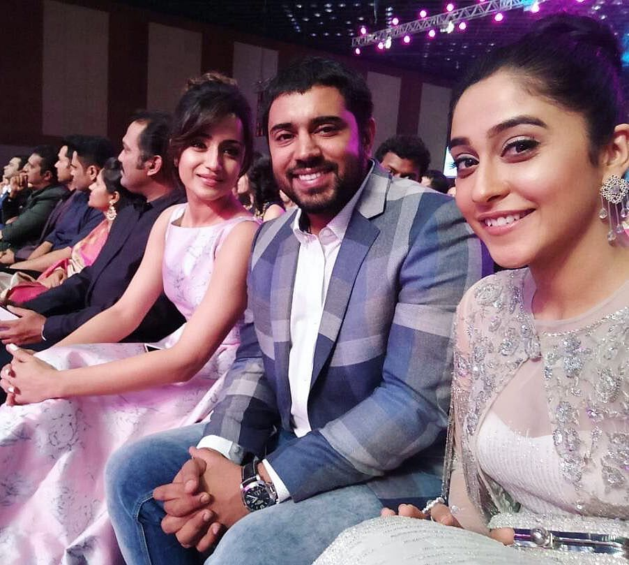 "Nivin Pauly with Trisha Krishnan and Regina Cassandra at the awards. (Photo courtesy: <a href=""https://twitter.com/karthick_trisha/status/876326808865587202"">Twitter/ karthick_trisha</a>)"