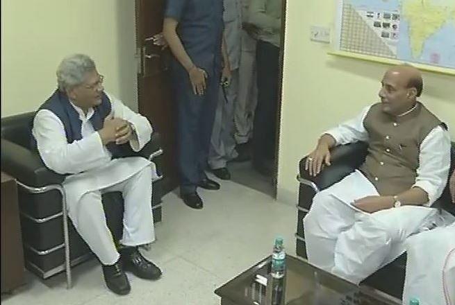 Union Minister Rajnath Singh with CPI(M) leader Sitaram Yechury. (Photo: ANI)