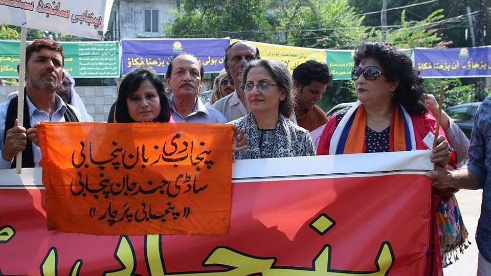 Residents of Punjab in Pakistan participate in a street march to raise awareness about the Urdu language. (Photo: Vivek Shukla/ <b>The Quint</b>)