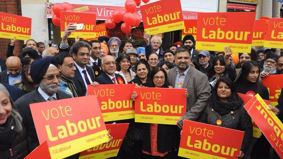 """Labour party candidates Virendra Sharma and Seema Malhotra with the Indian-origin community. (Photo Courtesy: Facebook/<a href=""""https://www.facebook.com/virendrasharmamp/"""">@VirendraSharma</a>)"""