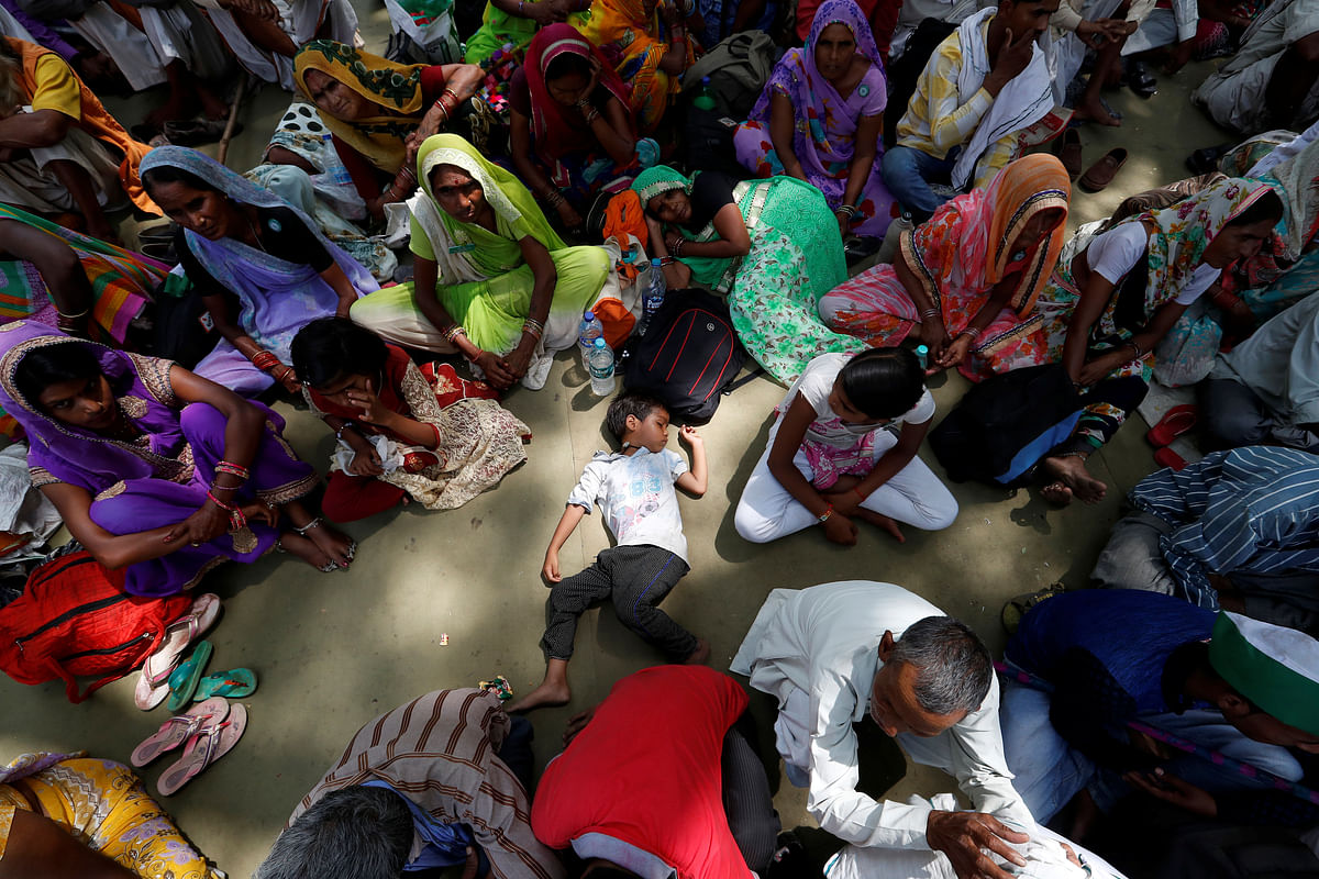 A boy sleeps as farmers attend a protest against the killing of five farmers in Mandsaur, Madhya Pradesh. (Photo: Reuters)