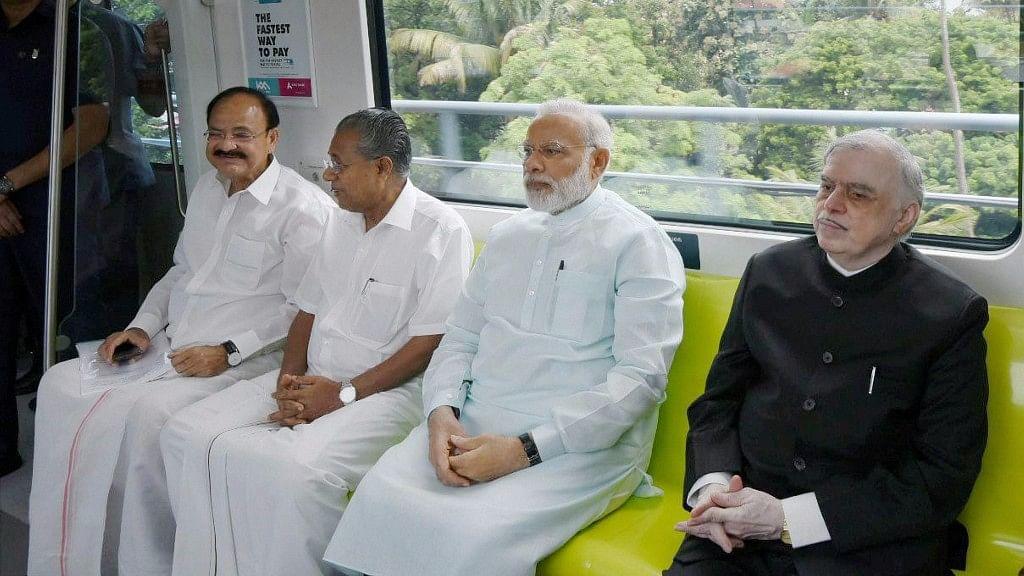 Prime Minister Narendra Modi, Kerala Governor P Sathasivam, CM Pinarayi Vijayan and Union Minister Venkaiah Naidu take a ride in the newly launched Kochi Metro in Kerala on Saturday. (Photo: PTI)