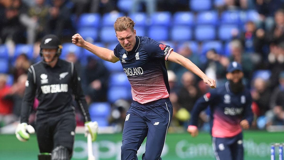 England's Jake Ball celebrates taking the wicket of New Zealand's Luke Ronchi. (Photo: AP)