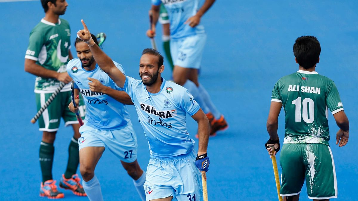 India's Ramandeep Singh celebrates scoring their first goal during the Men's World Hockey League match. (Photo: AP)