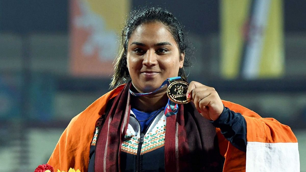 Manpreet Kaur shows her medal during the presentation ceremony of the Women's Shot Put event during the 22nd Asian Athletics Championships in Bhubaneshwar