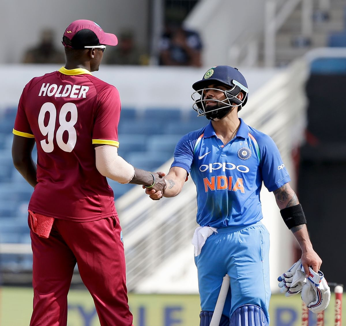 West Indies' captain Jason Holder and India's captain Virat Kohli shake hands after India won  their fifth ODI at the Sabina Park by 8 wickets.