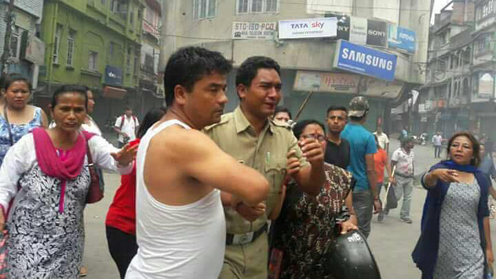 Locals in Kalimpong guide a policeman to safety.