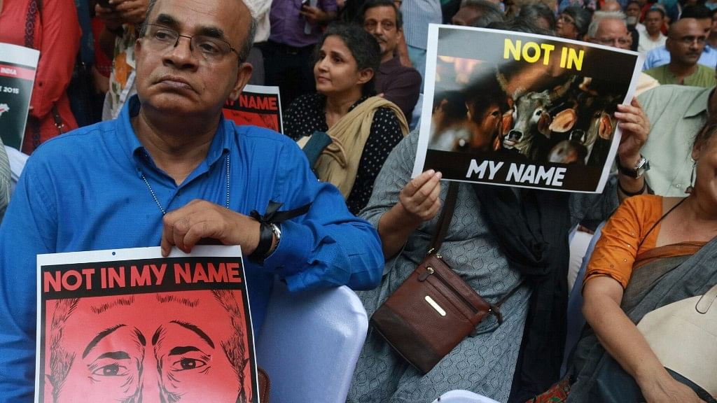 "People participate in ""Not In My Name"" protest against killing of Junaid Khan in New Delhi on 28 June 2017."