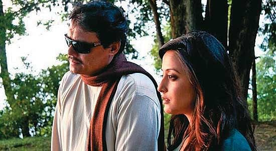Saswata Chatterjee and Raima Sen in a still from <i>C/O Sir</i>.