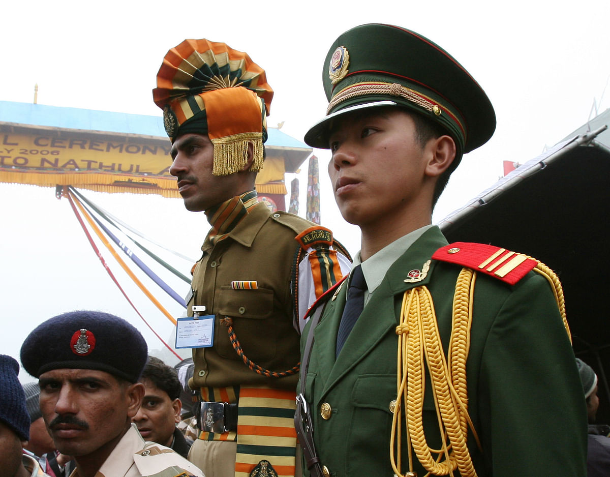 Chinese and Indian border guards stand at the Nathu La mountain pass, between Tibet and  Sikkim.