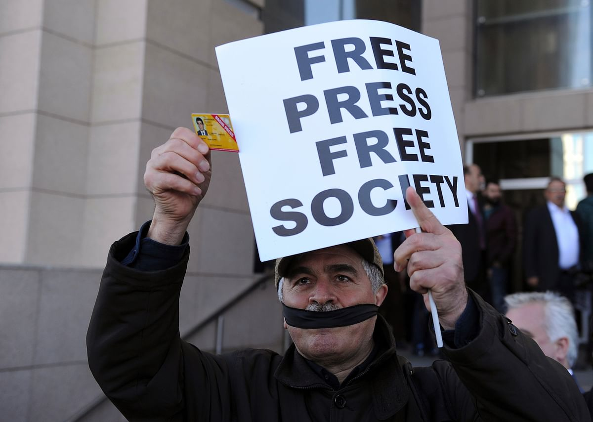 A Turkish journalist protesting against the crackdown on Turkish press.