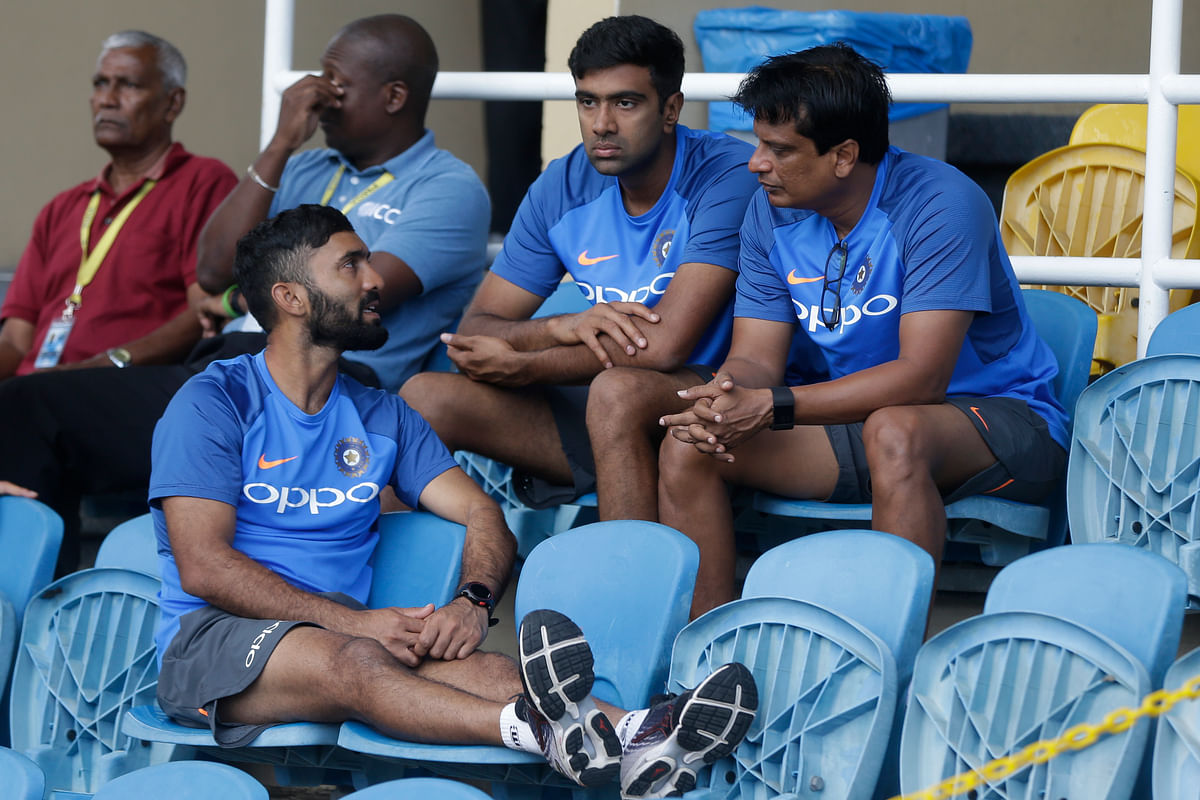 India's Dinesh Karthik, bottom, chats with teammates at the pavilion. (Photo: AP)<a></a>