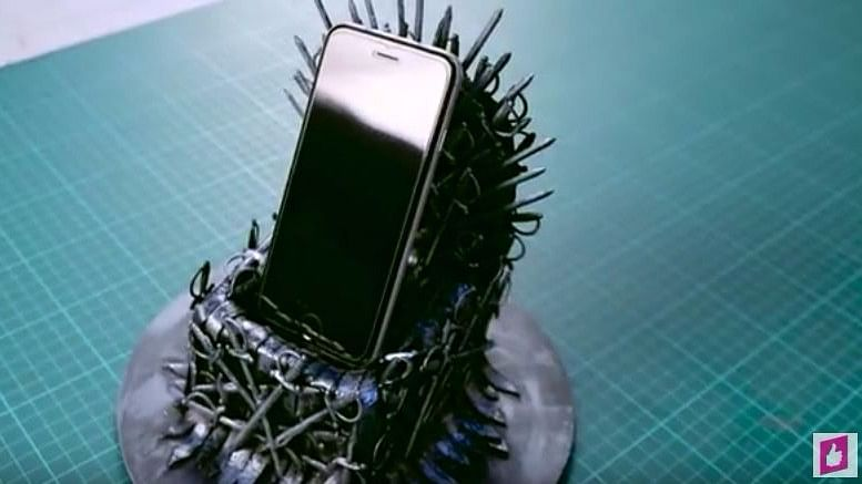 An iron throne phone stand.