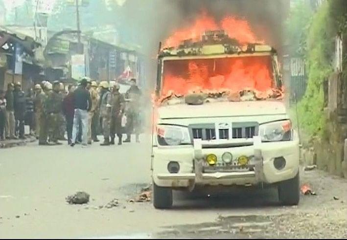 A police vehicle set ablaze by pro-Gorkhaland supporters.