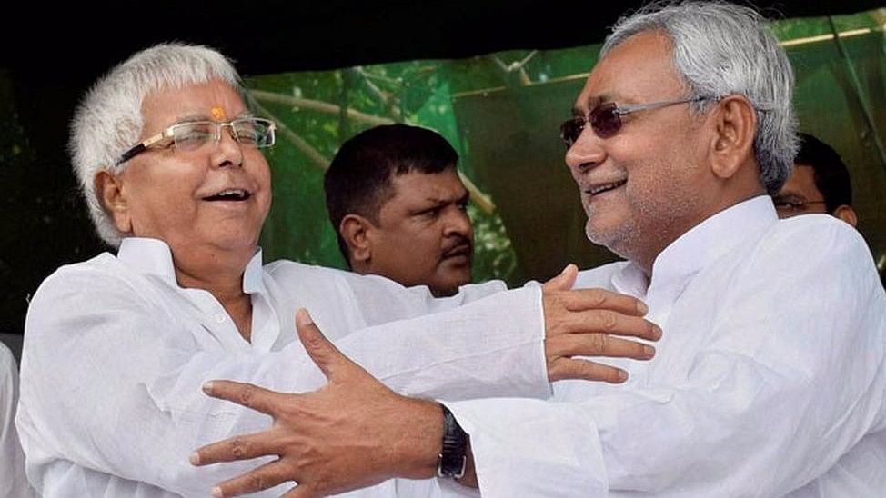Lalu Yadav and Nitish Kumar after their victory in the Bihar Assembly elections.