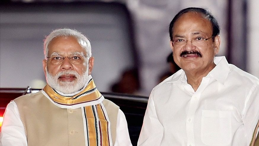 Union Minister M Venkaiah Naidu is greeted by Prime Minister Narendra Modi after he was announced as the BJP's Vice-Presidential candidate in New Delhi on Monday.