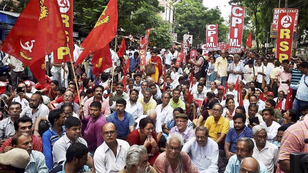 Left activists take part in a rally to protest against state government in front of Calcutta University in Kolkata on Tuesday.