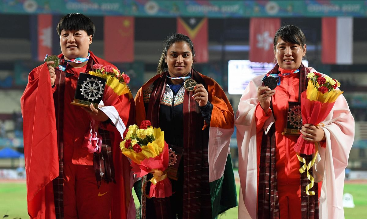 Manpreet Kaur flanked by Chinese athletes Guo Tianqian (Silver) and Aya Ota (Bronze) during the presentation ceremony of the Women's Shot Put event during the 22nd Asian Athletics Championships in Bhubaneshwar