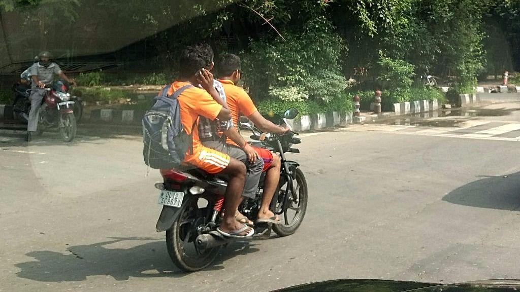 Traffic violations by Kanwariyas in Delhi.